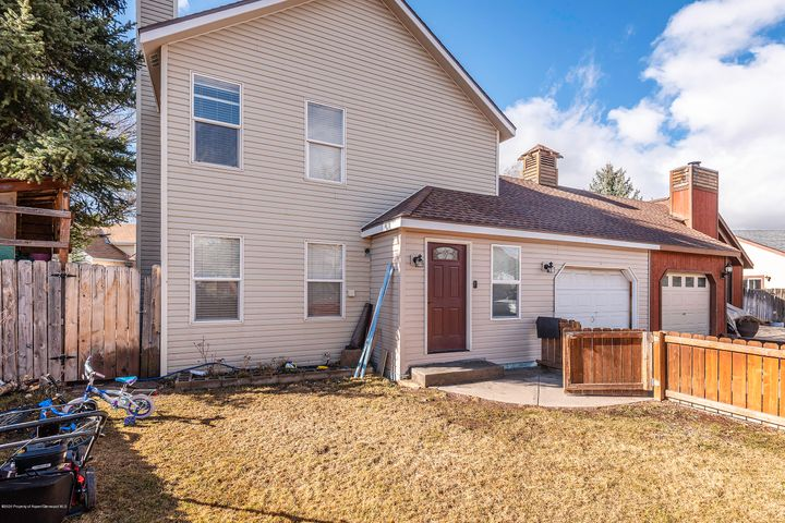 Been hunting for a home in Carbondale? Come explore this 1300+ square foot, three-bedroom townhome. The seller renovations include bathrooms, a sliding glass door in the dining room providing easy access to the fenced yard, a new front door, and recently painted interior spaces.  Gather around the woodstove, work in the garage and add your personal touch. Seek no further, make this your new home. No HOA fees.