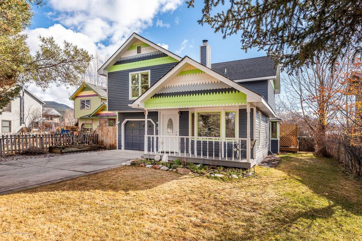 Centrally located Victorian style home with vaulted ceilings, open floor plan, and a wood burning fireplace. Enjoy the very private fenced backyard with automatic sprinkler system and the Carbondale Ditch flowing through!