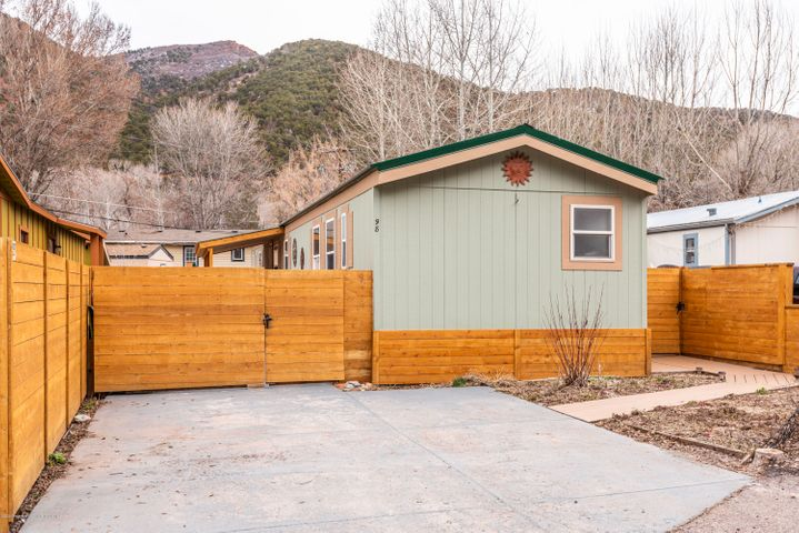 """Lazy Glen Home + Land. This 1,280sf , 3 bedroom, 2 bathroom home sits on a 4,595sf fenced lot. Open concept floor plan. Vaulted ceilings throughout. Upgrades include new roof - 2016, new decks, new sidewalks, landscaping, new fences, gas fireplace & new washer. Exterior is complete with fenced yard, patio, dog pen and shed. Located on a cul-de-sac. RFTA bus service. Dogs allowed. HOA Dues $333/mo. Property is NOT in a flood zone. Close to Basalt and only about 25 minutes from Aspen. Deed Restricted to Resident Occupied (RO) by Aspen Pitkin County Housing Authority (APCHA). Buyer must work a min. of 1500/hrs/yr. in the Roaring Fork Valley(Aspen to Glenwood). Must be owner occupied. There is no sale price restriction. This is a 16x80,1998 mobile home (HUD). Lazy Glen HOA doc's-www.apcha.org HOA Dues: Total $333/mo which includes $150/mo plus $33/mo for upgrading water for fire suppression required by fire department started in 2013 and will continue for ten (10) years plus $150/mo for Capitol Improvement Assessment for upgrading sewer system required by the State of Colorado.  Mobile home title has been purged. There are """"tie-downs"""" required for most bank loans.  Aspen Pitkin County Housing Authority (APCHA) requires that all buyers take a Home Buyer Education Course offered online or in person. Call them at 970.920.5050 
