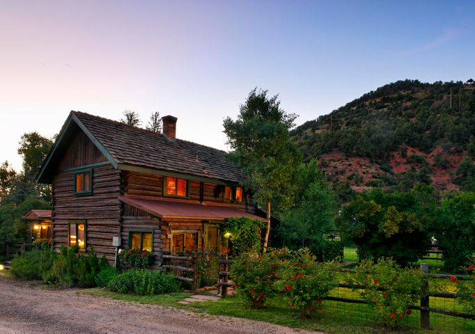 The Snowmass Cottages, rich in Aspen History, sits on 5.7 acres along the banks of the Roaring Fork River. The property features a Historic Log House, 7 Cabins, a 1,650 Sq Ft finished and heated garage, manager unit, gardens, senior water rights and only 20 minutes from Aspen. An existing building envelope and pending building permit allows for a 3,500 square foot home 20 feet from the river, which can't be duplicated today.  It also allows for a 1,000 Sq Ft FAR for addition dwellings. Small resort, rental income, or create you own family compound or horse property... The possibilities are endless!