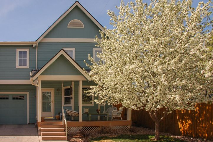 Warm and charming duplex located at the end of a quiet cul-de-sac. This 2BR/2.5BA home has a spacious loft that overlooks the vaulted ceiling living room. The loft could be easily converted to an office or 3rd bedroom. Great amenities are throughout the home. Jotul gas stove in the Livingroom, washer and dryer located upstairs near bedrooms, RO Filter in kitchen, water softening system for entire house, new exterior paint, and new carpet on main level. Cute fenced backyard with sprinkler system and a flower garden. There has been one owner and this home has been kept in impeccable condition. COVID Showing Parameters in Place.