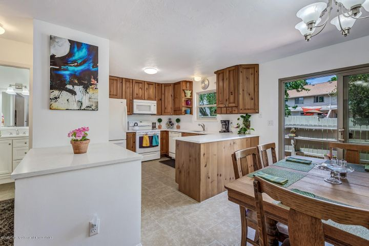 This new 2020 remodeled 3 bedroom, 1.5 bath, 1 car garage condo is ideally located in downtown Carbondale. Walking distance to parks, restaurants, the Rio Grande Trail and Main Street. The lower level has potential 4th bedroom and full bath to make this condo 4 bedrooms and 2.5 baths.  Landscaped fenced backyard with gate to HOA open space to play with your kids, dogs, and friends!  Upstairs Master has view of Mt.Sopris. Priced to sell at $500,000.