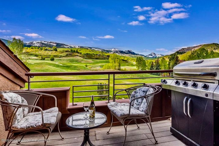 Large, top floor 2 bedroom/2 bath with vaulted ceilings and spectacular views of the ski area and surrounding mountains. Personalized with many high end furnishings and fixtures, and custom built-ins. Buyer may purchase a transferable Villa Gold membership to the Snowmass Club for payment of a $1,000 transfer fee. Located across the street from the Snowmass Club, where members can enjoy indoor and outdoor tennis; Golf for a $35/round Villa owner rate; pools; hot tubs; large athletic club; SAGE restaurant, and more. Free nordic ski tracks out the door in the winter; numerous bike paths in the summer. Close drive to Aspen via Owl Creek Rd. In the Aspen School District. The perfect ski/golf condo.