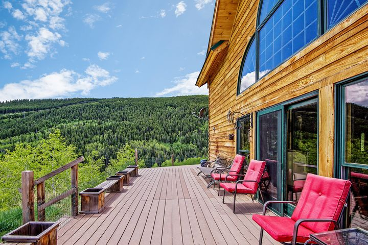 """Enjoy stunning views of Ruedi Reservoir as well as nearby Frying Pan River access to gold medal fishing from this spacious, classic log home. The shell of this custom built Kuhn Brothers log home (one of the best in the log home business) is comprised of 8'' square kiln-dried logs with dove-tailed corners. a gorgeous great room with high open-beamed ceilings, sandstone fireplace, Brazilian cherry floors, roomy kitchen with granite countertops & cherry cabinetry, dining area, library/parlor/formal dining room, a second-story loft with dramatic views, and a wrap-around trex deck. The 1.2-acre private lot overlooks a gorgeous mountain meadow which cannot be developed and which will forever remain pristine. Large expanses of National Forest lands complete the view. The main level master suite comprises an adjoining sitting room and spacious master bath with travertine shower, soaking tub, marble floors and counter, Kraftmaid wood cabinetry, Kohler toilet, and Moen fixtures. The kitchen features all cherrywood Kraftmaid cabinetry, granite countertops, custom marble inlay backsplash, Kohler sink, and stone flooring. The large foyer features limestone flooring with a custom marble inlay medallion which matches that in the kitchen. All the flooring, except where noted, is ¾"""" hand-scraped solid Brazilian cherry from the Biltmore collection. The great room features 23' cathedral ceilings with cloverleaf windows overlooking the lake. The dining room features stained glass windows and log beamwork , as does the great room trusses. The massive floor-to-ceiling fireplace of sandstone features a top-of-the-line Heatilator wood-burning stove insert. The custom cast-iron and wood baluster staircase has all Brazilian cherry flooring. The loft is quite large, and each bedroom is good-sized, with custom trim on doors and windows, and a stained-glass transom above each doorway. The main second story bathroom is large, with travertine floors, shower and Kohler soaking tub, Kohler toilet,"""