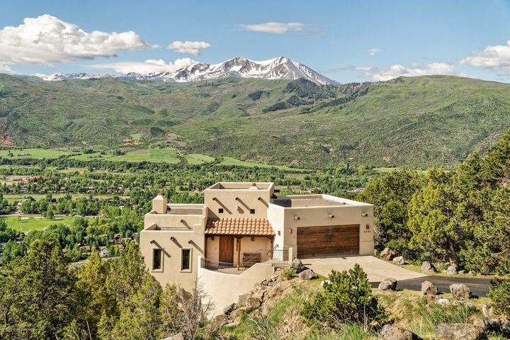 THIS COULD BE YOURS! Spectacular, panoramic mountain views is what you will see as you enter this private, front row Missouri Heights home, on the first ridge up from El Jebel/Willits. Warm and welcoming is what you'll feel once inside this Southwestern style home. Watch incredible sunrises, sunsets and everything in between, including Aspen Highlands, Snowmass and Mt Sopris, from multiple decks or from the hot tub. There are 4 bedrooms, 3.5 baths, 3095sf on 2.38 wooded acres, with a newly re-stuccoed exterior and paved driveway. Experience for yourself the peace, tranquility and majesty of the Rocky Mountains in the Roaring Fork Valley. Priced at $1,685,000, turn key, mostly furnished and accessorized.