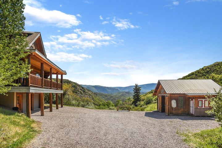 Tucked away in the Old Snowmass, Colorado, just 30 minutes northwest of Aspen is a stunning 38 acre parcel of land, with a beautiful 3 bedroom, 2 bath log home. This spectacular mountain ranch offers end of the road privacy, mountain valley views, abundant wildlife and solitude. Remodeled in 2018 the kitchen features granite counters, wood floors, custom cabinets and new stainless steel appliances. Additional features include a barn, dog run, chicken coop, horse arena and fenced pastures. A great escape for those looking to breath fresh mountain air within 25 minutes to Pitkin County Airport.