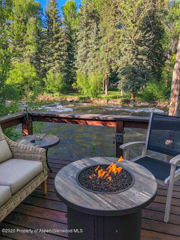 Riverfront!  Fish from your deck! Space, privacy, tranquility. Magical end of the road retreat on the banks of the Roaring Fork. There are two homes on this hidden gem of a 2-acre property: a romantic 1258 sq ft 1-bedroom Victorian cottage on 200' of riverfront, and a charming 1078 sq ft studio/greenhouse. Newly remodeled kitchen, dining, new hardwood floors and countertops. The property features magnificent gardens with extensive in ground irrigation, perennials and flowering trees, an expansive deck overlooking the river and a small pasture. Both homes have been meticulously maintained, but there are also many redevelopment opportunities possible on the site (see Docs for land use analysis). 10 minutes to Aspen, 10 minutes to Basalt and Willits. Aspen School District.