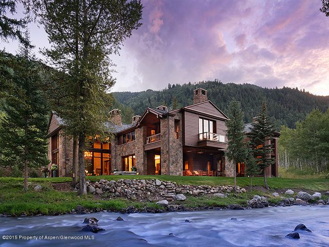There may be no finer property to grace the banks of the Roaring Fork River that combines the attributes and amenities of this exclusive compound. Thoughtfully designed and meticulously crafted, the quality and style is undeniable. Combining an exquisite main house with a charming guest house and separate caretaker's quarters, these three primary living areas meld to create an unrivaled gated riverside retreat on 10.5 acres.  The main house is over 13,000 square feet and includes 5 bedrooms, 6 full baths, 3 half baths, and a 4 car garage.  Combined with the 2 bedroom, 2.5 bath guest house with 2 car garage and 1 bedroom, 1 bath caretaker's quarters there is a total of over 17,000 square feet of heated living space.