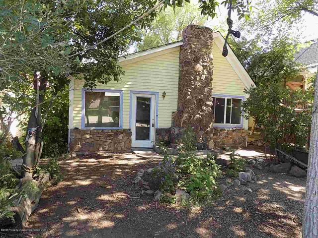 DOWNTOWN EVERYTHING!  Great location on this one level home in Carbondale. 200 feet from Sopris Park!  One block from pool and bus stop! Two Blocks from Post Office!  You get the idea!  3BR, 1 bath with fenced back yard, storage shed, mature trees.  The home is a Carbondale Original, over 100 yrs old with various remodel done over the years. Home needs some updating and upgrading, but is totally livable as is and located where nothing is too far away. Natural gas wall heater heats the home well, wood burning fireplace in the living area. Lots of upside to this property, the possibilities are up to you!  Home has been a rental for the last 15 years and is being sold as-is.