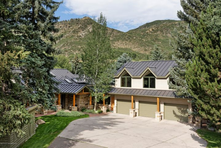 Passive solar designed home upgraded over the years providing a sanctuary on the Roaring Fork River conveniently located 10 minutes from Aspen, Snowmass Village and Basalt. Vaulted ceilings, an abundance of glass and a wood burning fireplace in the spacious living room provide a warm, natural light environment to watch those incredible winter snow storms.Wonderful entertaining home that can accommodate a large family retreat on the river. The park like setting in Little Texas community offers an enjoyable place to walk and easy access for some great year round fly fishing. Views, sunshine and river frontage are a rare find in the world but this end of the road property has it all. Deeded easement thru River Rock Lane to lower property on the river for catering, handicap, etc access.