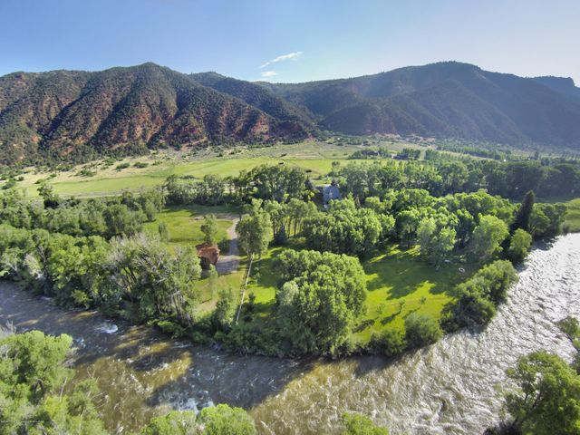 A must see property with extensive river frontage! Flanking both sides of Lower River Road, nearly 38 acres of pristine land offers manicured and mature gardens and trees, upper pasture with 10+ acres, pond with fountain and creek. Private road affords owner rare vehicle access to Roaring Fork River campfire site. Substantial Water and Water Rights. Existing structures include the upgraded 5 bedroom, 3.5 bathroom home and a newly-constructed 2-level storage building (approx. 2500 sq ft) with beautiful exterior aesthetics. Located just minutes from the Roaring Fork Club and only 10 minutes from Basalt, the property also features easy access to Rio Grande Trail for riding, biking, running, and cross country skiing.  *Interior photos coming soon.
