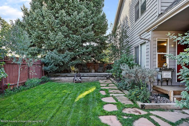 This end unit, three-bedroom, two and one half-bath townhome is well-located just a few blocks from Main Street in Carbondale and across from Giannetti Park. With views of the Red Hill and within walking distance of the Nature Preserve, this home has beautiful spaces to relax inside and out with a lovely yard and deck and comfortable living areas. This is a rare opportunity that is in high demand.