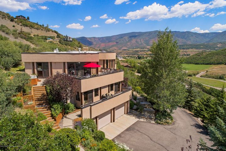 Privacy, views and convenience!  Perched above Brush Creek , this single family home boasts views from the Snowmass ski resort, across the 800 acre Droste Open Space  and  down the valley to McLain Flats and beyond.   This home is situated at the end of a private cul de sac with expansive decks to entertain and take in the balloons that float the canyons in the early mornings. There are 4 generous bedrooms with en suite baths and separate decks to relax, both inside and out.  Office/Den easily converts to a large 5th bedroom - possibly an enviable bunk room! The home also offers great separation of space with an entire floor dedicated to guests.   Large living room opening  up to the outdoor living spaces makes this a great destination.