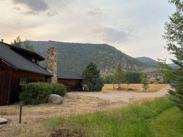 Incredible riverfront property offered for the first time by the original family owners.  5 flat acres with water rights perfect for a redevelopment opportunity or potential extensive remodel all located within the Aspen school district.