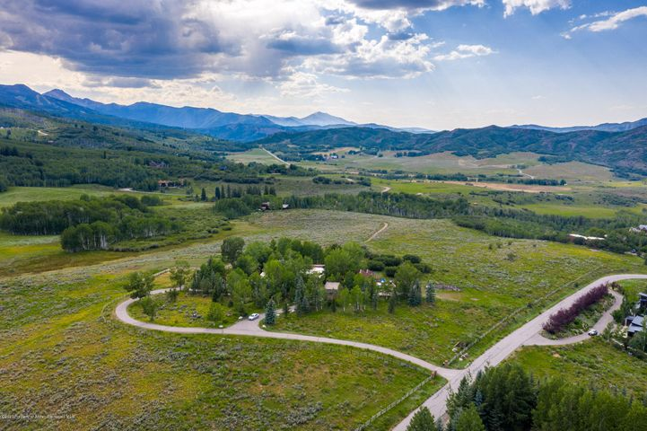 Rarely available - an expansive, 56.9 acre lot in the coveted West Buttermilk neighborhood. This lot is situated directly between Aspen and Snowmass with access to many recreational trails - by foot, snowshoe, ski, bike or horse. Enjoy privacy and peace, yet have the ability to get to Aspen or Snowmass in a matter of minutes. Sweeping views, a large pond and stream make this the quintessential building site for the perfect Aspen estate. Live in the existing 7,855sf structure or build your dream home.