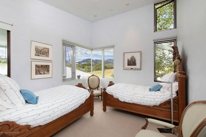 This contemporary, mahogany-clad house includes floor to ceiling windows and doors that flood the living spaces with natural light, providing numerous ways to wander from the warm interior to the patio areas immediately outside. Elegant but casual, sitting on 12 acres looking south over 60 acres of meadow and 360 degree majestic mountain views.