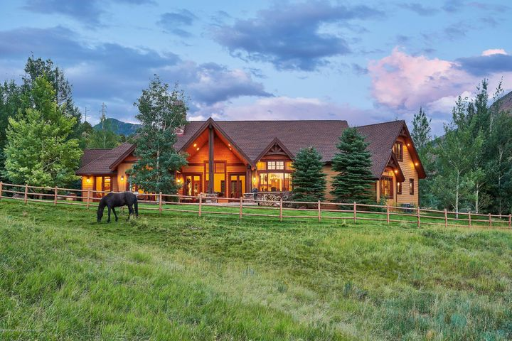 Here you will find a most impressive mountain home on 58+ idyllic acres where you and yours have free range.  Pastures, red rock hillsides, and long western views captivate all who visit. Handsome architectural features of stacked stone, wood beams and wrought iron echo throughout generous indoor and outdoor living spaces.   Imagine sunsets over fields full of wildlife and sunrises over Aspen Highlands.  Four well-appointed suites, plus a one-bedroom apartment above the garage will host family and friends from far + wide while an oversized 3-car garage, plus a barn accommodate all your recreational toys or maybe some horses. With BLM land and the Rio Grande Trail bordering the property, a 20-minute drive to Aspen Snowmass  and a quick drive to Basalt, the opportunities for fun are endless.