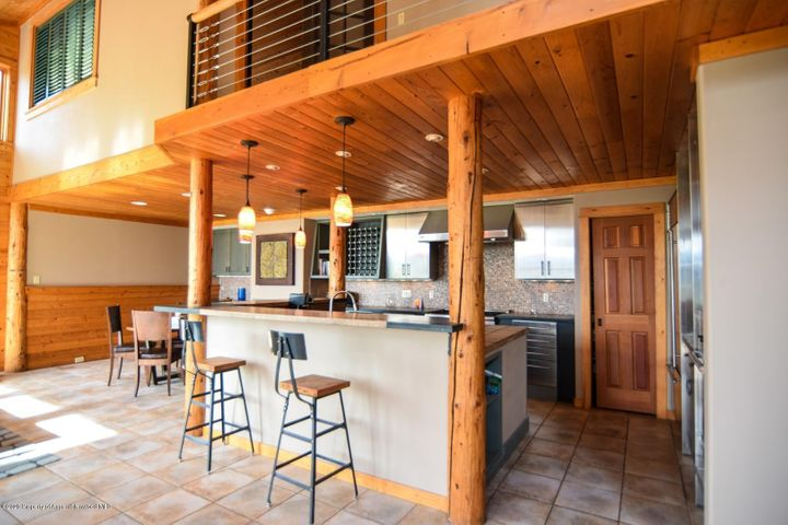 Beautiful gateway single family home situated on almost an acre with unbeatable mountain views and privacy. Vaulted ceilings compliment this three bedroom, three bathroom home with 2,795 square feet of living space. The home features exposed wooden beams, south facing windows,beautiful gourmet kitchen with Thermador appliances and custom cabinetry. A very large attached artists studio (or 4th bedroom or lock off Mother in law suite) above the two-car garage. Newly remodeled master bath with steam shower. Newly painted and stained interior and exterior in 2018. Wonderful and private outdoor spaces with newly refinished deck including and a brand new 2020 hot/spa to enjoy the sunsets. Ample parking with a newly paved driveway!