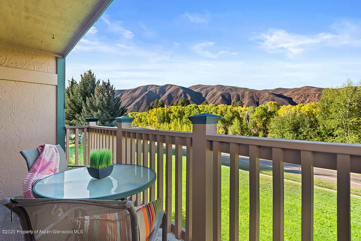 Roaring Fork River views from the deck. Terrific upstairs location with lots of volume and natural light. Move in ready - Freshly painted and new carpet with additional features of Hunter ceiling fans,  and attic fan cooling system. In the heart of Basalt - close to schools, restaurants, shops.