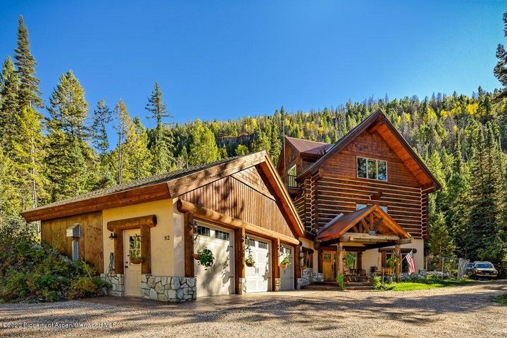 Looking for the Colorado dream?  Here it is!  Beautiful 3,666 square foot log home in a quiet peaceful mountain location!  One owner custom log home on three levels with bedrooms & baths on each level. Amazing attention to detail and lots of well thought out extras. The lower level has a game room with wet bar, ping pong and pool tables. The main living area is light and bright with large windows, lots of light, large, custom country kitchen and open dining and living areas. A huge trex-deck is just outside the living area with access to the beautifully landscaped fenced yard. Upper level is all master suite with a large master bath and walk-in closet, sitting area and office area with access to 2 small decks and great views!