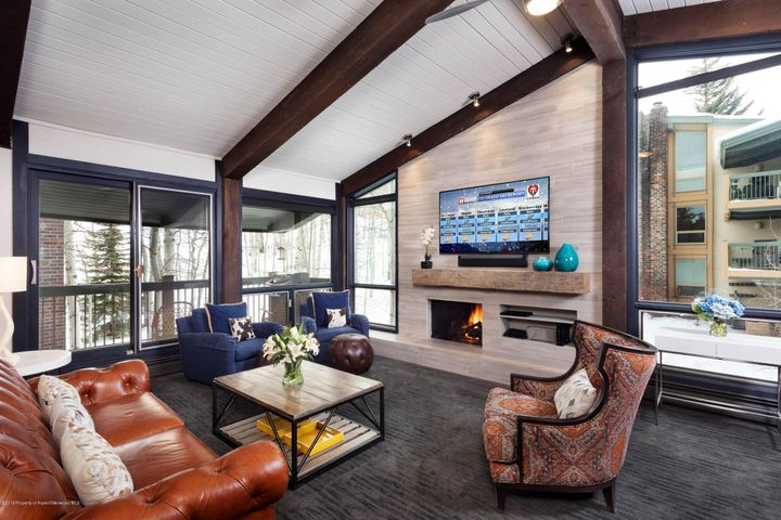 Top floor. Top shelf.  Completely renovated in 2015, this stunning mountain modern designed condominium features floor to vaulted ceiling windows that look out to Dawdler ski run and up to the Big Burn through an alpine aspen grove. Finishes include chenille white vein-cut limestone fireplace surround. A new kitchen was added with stainless appliances and quartz counters. The guest bedroom sleeps four as in-wall bunk beds were added. Ski-in/out. Beautiful outdoor heated pool and hot-tub area. Assigned carport. Owners allowed pets.