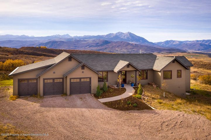 Endless mountain views and privacy abounds in this midvalley jewel. A feeling of being on top of the world, with 360 degree views, yet within a 15 minute peaceful drive to Hwy 82, Whole Foods, Willits, and Carbondale. Well laid out floorplan with main floor living and extra room for family and guests from a lower level walk out. Finishes include cherry cabinets, red oak solid wood flooring, custom concrete countertops, alder doors and trim, and large windows to capture the light and panoramic views. One can see for miles and revel in the ever changing sunrises and sunsets on the magical Mt. Sopris and the rest of the Elk Mountains. No HOA, so bring all of the toys. Three well built sheds for additional storage if the large 3 car garage isn't enough space. $1k per year road maintenance.