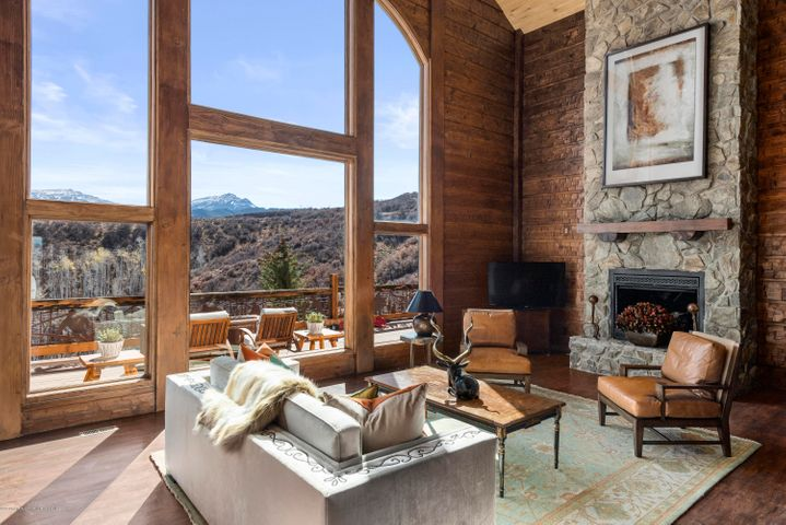 Perched upon a private knoll with 360-degree panoramic views and nearly 49 acres of solitude, this ranch property is well-appointed in design, location and luxury. Enjoy unparalleled privacy, yet only 25 minutes outside of Aspen. Serving as the centerpiece of this mountain retreat, the spacious kitchen has rustic wood floors and ample space for cooking and entertaining, as it opens to the dining and family rooms. The expansive decks and a pergola make three-season indoor/outdoor living and entertaining a pleasure. The tranquil first-floor master suite features a gas fireplace, walk-in closet, master bath with jetted tub and deck access. Two second floor bedrooms are impressive with vaulted ceilings, and each with their own spa-like master baths. A bunk room, wine cellar and game room add t ... add to the allure of this retreat. With impressive views and incredible outdoor space, this ranch property provides an elevated approach to mountain living.