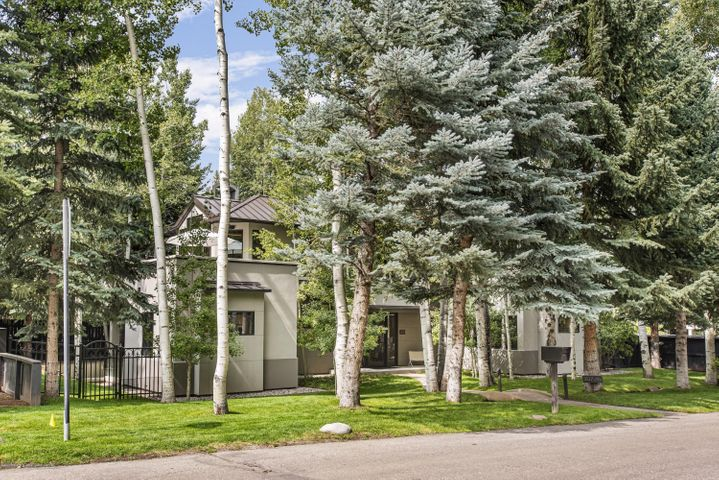 """This beautiful contemporary single-family home is located on a 6000 sq. ft.  wooded lot, with a stream, in Aspen's Prestigious West End and exudes peaceful, calm living.  A short walk to the Aspen Meadows and the Aspen Music Festival tent, serviced by The Downtowner, Aspen's free car service, and one block to the free skier shuttle the location could not be more convenient.  The entry level features a gracious foyer, two bedrooms, large laundry room, mud room and a 2-car garage. The open living area encompassing the living room, dining room, gourmet kitchen, powder room, and patio along with the master bedroom are on the upper level. The living room features a vaulted ceiling and Le Corbusier living room furniture that you can just sink into and enjoy the fireplace ... This beautiful contemporary single-family home is located on a 6000 sq. ft.  wooded lot, with a stream, in Aspen's Prestigious West End and exudes peaceful, calm living.  A short walk to the Aspen Meadows and the Aspen Music Festival tent, serviced by The Downtowner, Aspen's free car service, and one block to the free skier shuttle the location could not be more convenient.  The entry level features a gracious foyer, two bedrooms, large laundry room, mud room and a 2-car garage.   The open living area encompassing the living room, dining room, gourmet kitchen, powder room, and patio along with the master bedroom are on the upper level. The living room features a vaulted ceiling and Le Corbusier living room furniture that you can just sink into and enjoy the fireplace while catching up on current events from the 36"""" flat screen.  The living room also opens up to a large patio with comfortable, sectional outdoor seating and a barbeque grill.  The chef's kitchen includes a Sub-Zero fridge, Wolf appliances, DeLonghi espresso maker, Nespresso, Sub-zero wine cave, 6 burner gas stove and more.  There are 4 seats at the bar, a formal dining alcove for 8.    For a more casual gathering, the lower level has a m"""