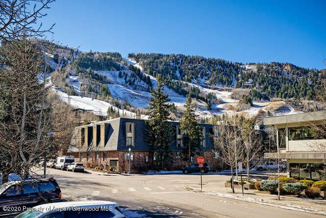 REMODELED  to the studs ! 2 bedroom / 2 Bath Aspen Core condo. 2 blocks to the Gondola. Dedicated parking. First floor patio with Ajax views. Lowest HOA dues in the core. Dogs welcome .Great investment property