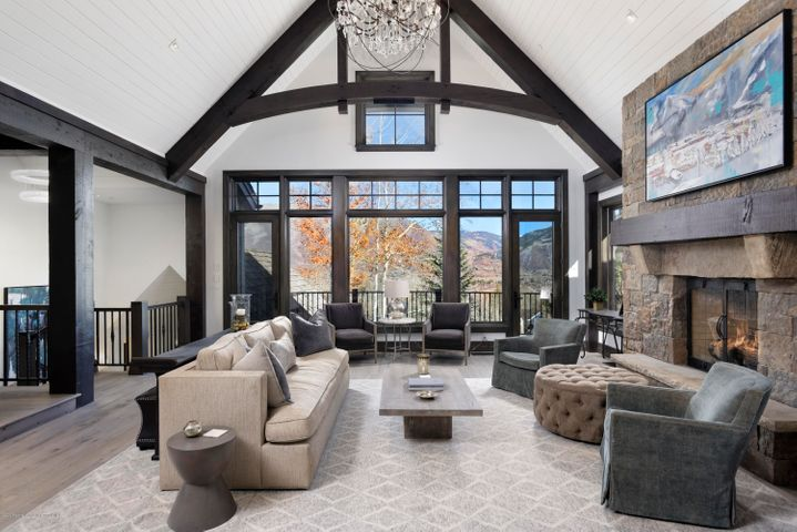 Create family memories to last a lifetime in this newly re-modeled, fully-furnished, legacy ski-in/ski-out estate located on a quiet cul-de-sac at the base of Tiehack. 8,256 sq.ft. of luxurious interiors and a smart four-level floorplan features a great room, six oversized ensuite bedrooms, media/game room with bar, hot tub, decks and patios, and private top floor master suite. Unobstructed up and down valley views and back door access to world-class golf, skiing, hiking and biking.