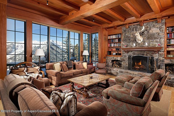 When you dream about living in the mountains, this is what it looks like! This quintessential Aspen Ski Chalet is situated on 48 acres on a private ridge on the backside of Aspen Mountain at the confluence of Little Annie's Basin and Midnight Mine Road. Ski home from Ajax or ski tour out your front door. Timeless woodworking and custom craftsmanship by Rutger's Construction distinguishes the 3,461 sq.ft. main house with four ensuite bedrooms plus powder room, gym and library, den. Floor to ceiling windows in the great room and upper-level master bedroom capture perfectly framed views. A two-bedroom guest house equipped with kitchen and wood stove is located below the main house. This is the ultimate Aspen Mountain ski retreat with forever views and surrounded by White River National Forest When you dream about living in the mountains, this is what it looks like! This quintessential Aspen Ski Chalet is situated on 48 acres on a private ridge on the backside of Aspen Mountain at the confluence of Little Annie's Basin and Midnight Mine Road. Ski home from the Sundeck and Silver Queen Gondola or ski tour Little Annie's out your front door. Timeless woodworking and custom craftsmanship designed by Wayne Paulson and built by Rutger's Construction distinguishes the 3,461 sq. ft. irreplaceable main house with four en suite bedrooms plus powder room, gym and library, den. Floor to ceiling, south facing windows in the great room and upper-level master bedroom capture perfectly framed views of Five Fingers, Conundrum Valley, Highlands Bowl and Ski Hayden. The open great room is centered around a Colorado moss rock wood-burning fireplace that warms the home. Pine flooring and radiant heat are throughout. A library, den media room with flatscreen and built-ins for your favorite books is ideal for post ski movies or a cozy read. A main level guest master suite with vaulted cupola spa bathroom includes separate marble shower, dual vanities and a soaking tub that looks out over the forest canopy. The upper-level landing features a comfortable seating area with built in nooks, a favorite for kids after a day playing in the mountains. A two-bedroom guest house designed by Al Beyer is equipped with kitchen and wood stove and is located below the main house. A caretaker's studio with ¾ bath, garage and shop with engine hoist and all of the necessary equipment to maintain the property provides on-site housing for your property manager. A solar system with back-up generators and 28,000-gallon propane tanks ensures off the grid power. This is like owning your own private Aspen Mountain Sundeck with an expansive south facing front patio and a hot tub nestled on the hillside. This is the ultimate Aspen Mountain ski retreat with forever views surrounded by White River National Forest that cannot be re-created today with current zoning requirements.