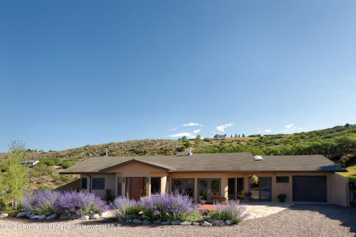Easy maintenance, three-bedroom sanctuary delivering privacy & stunning panoramic views of Mount Sopris & the Elk Mountain range highlight this single level home atop five+ lush acres. Features include an expansive window filled floor plan, remodeled kitchen with stainless steel appliances & granite countertops, a built-in gas fireplace, spectacular cherry wood floors, and natural gas in-floor radiant heat. In addition to the over-sized 1 car garage, there's a bonus space to create an office, art studio, kids playroom or gym. Lovingly upgraded and maintained, the exterior was recently re-stuccoed and the insulation enhanced. The highest quality finishes make this home move-in ready for your family and up to three horses, right down to enjoying amazing sunsets from your patio hot tub!