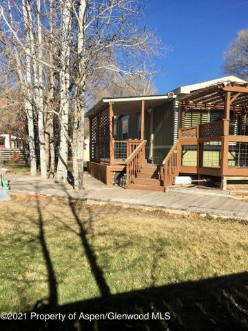 Enjoy living in Carbondale. This Upgraded well kept 2 bed 1 bath manufactured home has an open concept, new kitchen, plenty of sunlight and new floors. The Yard is fenced with a beautiful deck and views of Sopris. Includes 3 assigned parking spots.