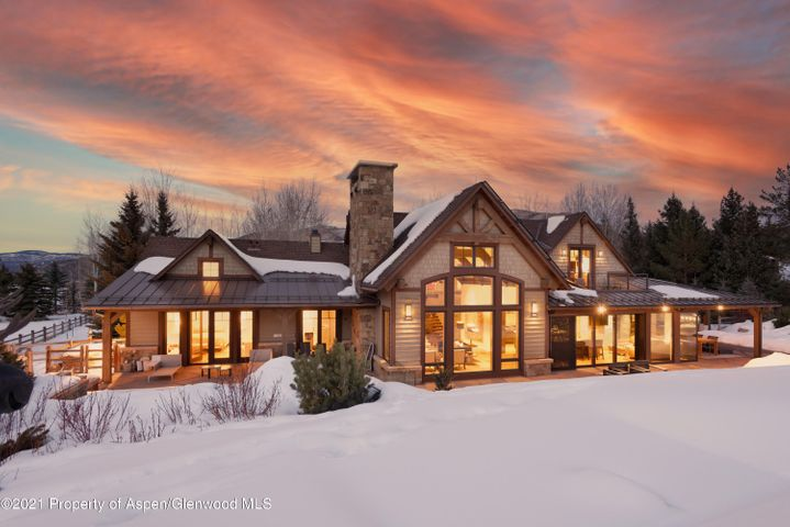 Starring brag-worthy views of Aspen Highlands and Tiehack, exceptional privacy, direct access to the cross-country trail system, expansive patio & decks and yet less than five minutes to town, the exceptional location of this recently renovated mountain contemporary home is second only to the inspired layout and finish of the interior living spaces. The expansive great room flows seamlessly into the formal dining room with glass-enclosed and climate-controlled wine storage to the casual and comfortable kitchen with adjacent sitting area, butler's pantry, large eating island and all of the amenities for any level of chef. The main floor master bedroom with adjacent sitting area, private patio & hot tub, spa-like bath and expansive master closet set the standard for opulent living, while the two additional en suite bedrooms on the main level enjoy privacy, access to the outdoors, and a shared sitting area with overflow built-in beds great for those larger gatherings. With two upper level areas, the first boasts an HD surround sound media room with adjacent full bath (easily converted to an additional bedroom if needed) and the second with a private en suite bedroom also perfect for a separate office or workout and massage area. Complementing the easy-living character is an oversized two car garage, abundant storage in the lower level, radiant heat in all bathrooms, central air conditioning, pristine gardens and a manicured yard for enjoyment in any season.