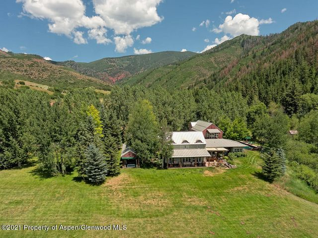 Woody Creek Farmhouse, this twenty-acre five-bedroom farmhouse, with an outdoor pool, provides the space you are looking for both inside and out.  Located just ten miles from downtown Aspen's vitality, you feel like you are living on a bucolic peaceful, countryside retreat. Each room is strategically oriented to capture dramatic views of the Elk Mountain Range. Great entertaining space, country kitchen, and inviting indoor/outdoor living.