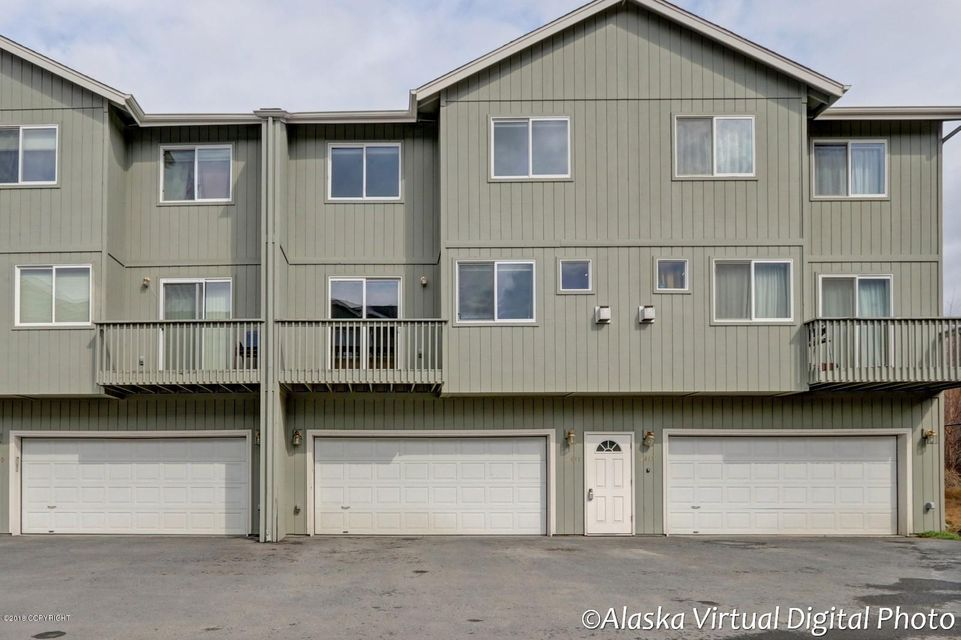 Immaculate condo. There is actually a 3rd bedroom that would be a perfect nursery. Would make an excellent den/nursery. New flooring throughout and fresh paint. Enjoy the fireplace year round and a balcony that boasts mountain views. Enjoy the oversized garage for plenty of room. So convenient for access to the Seward Highway to head all directions. Make sure to watch the virtual tour!