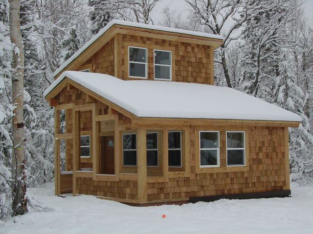Front of Cottage, Photo Similar. The two bedroom cottage has a second bedroom to the right on the first floor