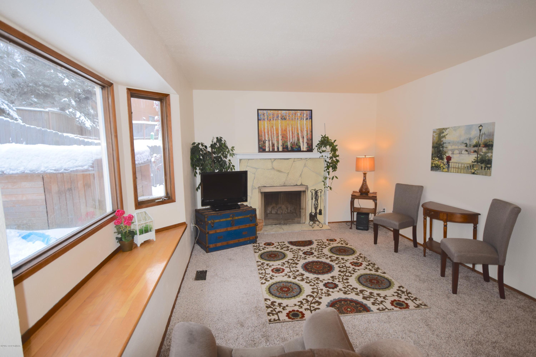 Living Room w/Fireplace & Bay Window