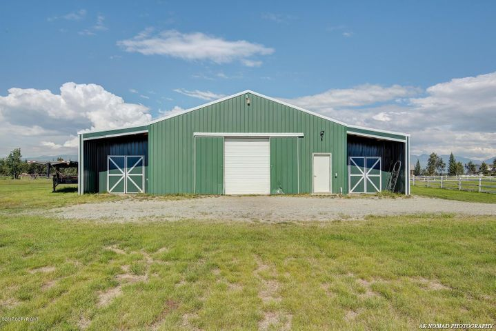 Useful building is a fantastic shop and barn has been used for both. In-floor heat and storage above main floor.