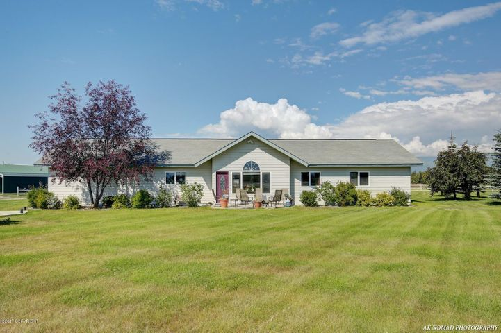 This lovely ranch home boasts 360 degree views, in-floor heat, 2.44 acres and so much more!