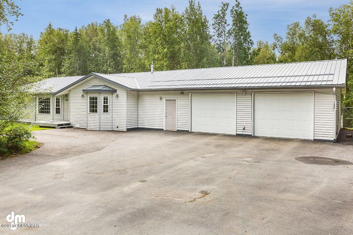 Large paved area easy to care for vinyl siding and metal roof.