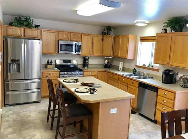 Huge kitchen with eating bar, stainless steel appliances, and an abundance of counter and cabinet space...