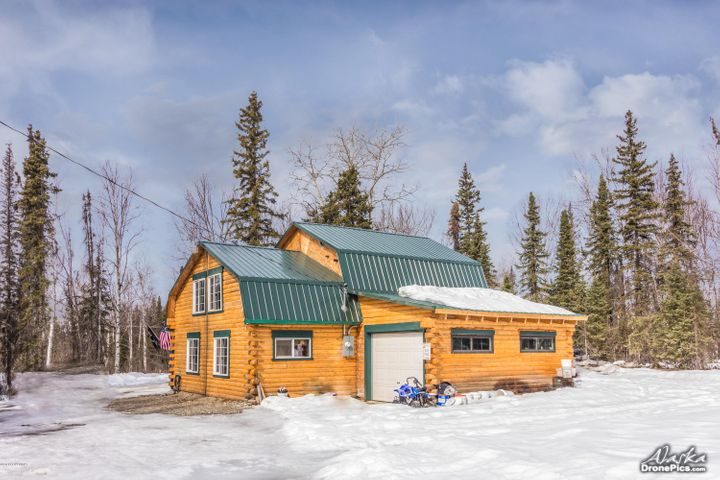 """Authentic """"Butt and Pass"""" style log home, with Garage sited on far side from road for privacy."""