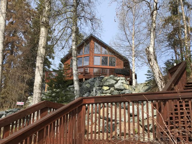 For people who want to live or vacation on Big Lake in style...This beauty was tastefully updated in 2010...You will lave the massive rock wall, rock gardens, and low maintenance landscaping...