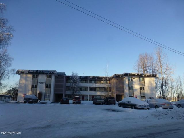 Bottom floor, end unit condo. Parking space is right in front of the entry door.