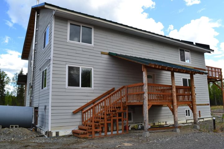 There is also a deck on the back as well as one upstairs for bedroom