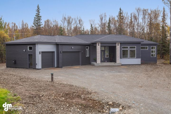 Modern cornered ranch home with 10' ceilings, 3 bedrooms, 2 full baths & oversized 3 car garage. Paved drive, great location close to Wasilla core and and all on a roomy 1 acre lot. Beautiful kitchen w/ quartz counters and waterfall island. Backyard RV access from Wasilla-Fishhook Rd makes it easy to store your Alaskan toys.