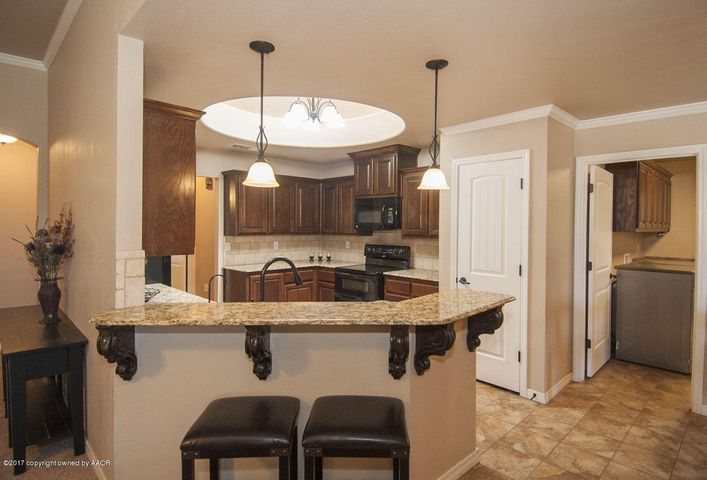 Kitchen is open to dining. Wonderful skylight, pantry, and custom cabinets.