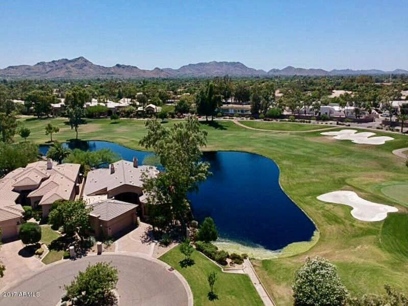 ''Two Year Builder Warranty''. Professionally remodeled single level home on one of the largest golf course lots on ''The Lakes'' golf course in the gated community of ''The Legend'' in Gainey Ranch. 3 Bedrooms/3 bathrooms plus a den. An absolute stunner that incorporates a transitional and contemporary flair. Step through the double entry doors and view this incredible redesigned open floor plan. Literally ''Jaw Dropping''. Nothing compares. Nothing! The redesinged gas fireplace is dressed in ''Natural Elise Sparkle Torreon''. New LED lighting brings out the brilliant sparkle at night. Adjacent is the refrigerated 210 wine bottled glass closet with double racking. The new sliding wall of glass is situated next to the glass wine closet. Wet bar with beverage center also situated perfectly.