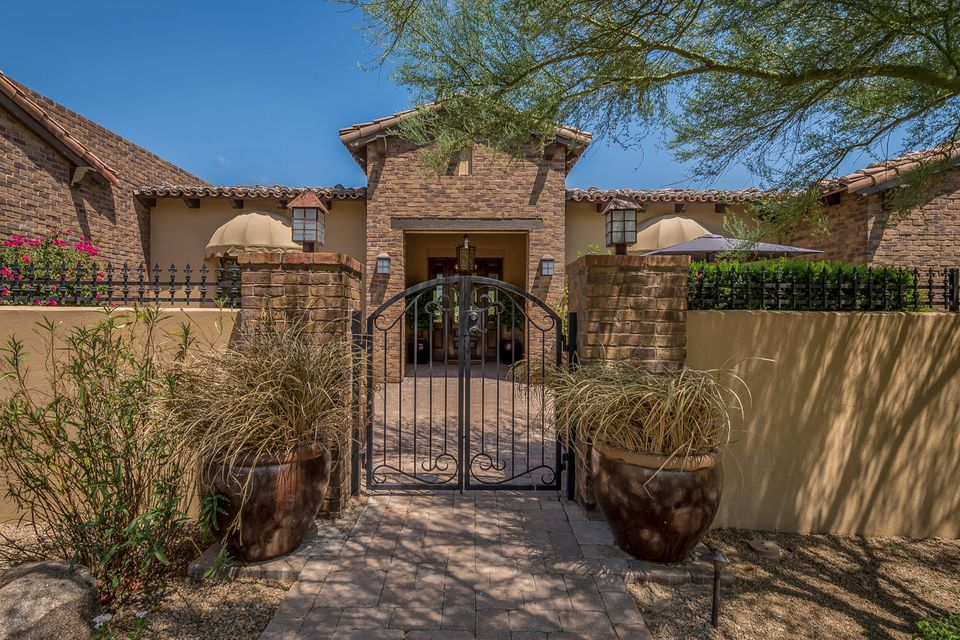 Situated on almost a full acre, in the heart of N. Scottsdale, this incredible estate will take your breath away.From the stunning curb appeal, to the picturesque views of the Mc Dowell's this home simply has it all. Stunning entrance with tons of natural light in the open great with canterra fireplace & entertaining area. Kitchen is gorgeous with a wonderful sitting space, cozy family room and formal dinning. Also a private retreat perfect for a glass of vino. Master retreat is stunning w/a sensational bathroom and spacious closet. Guest bedrooms are large with walk in closets. 4&5th bedrooms are currently office and workout areas. Last but not least in the backyard paradise. SIMPLY AMAZING! Pool and spa, bbq area gorgeous trees and views abound. Home is flawless and even better in person